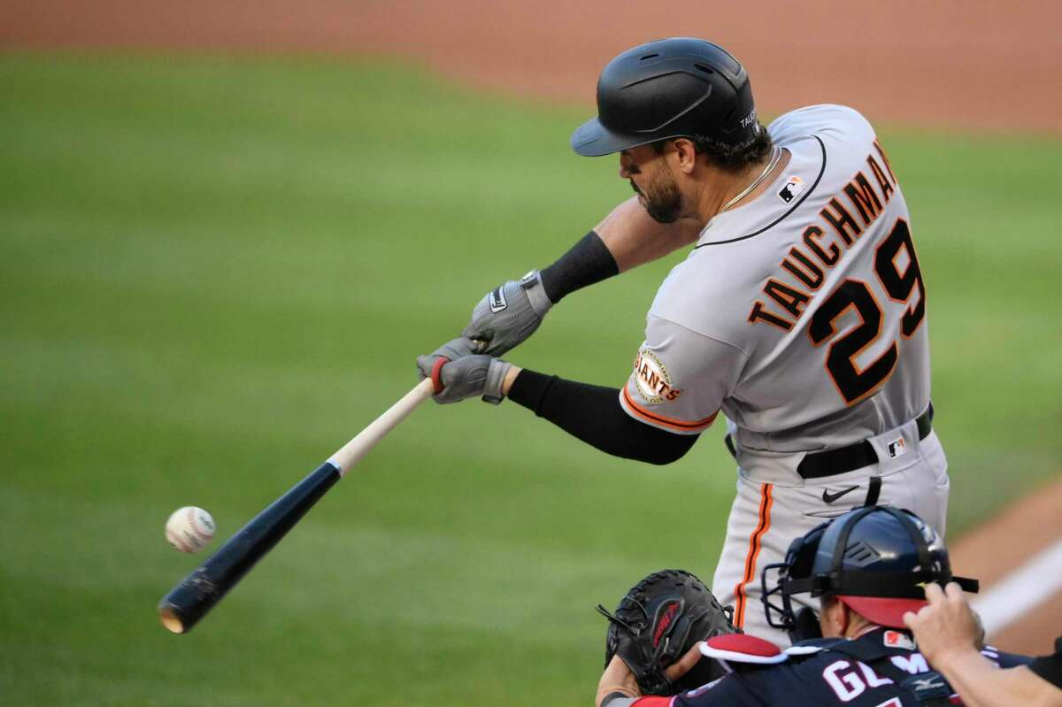 San Francisco Giants' Mike Tauchman bats during the first inning of the second baseball game of a doubleheader against the Washington Nationals, Saturday, June 12, 2021, in Washington. (AP Photo/Nick Wass)