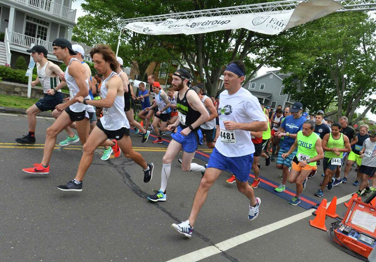 Runners in the mens division start the Faxon Law Group Fairfield half marathon at Jennings Beach in Fairfield Conn. on Sunday June 3, 2018.