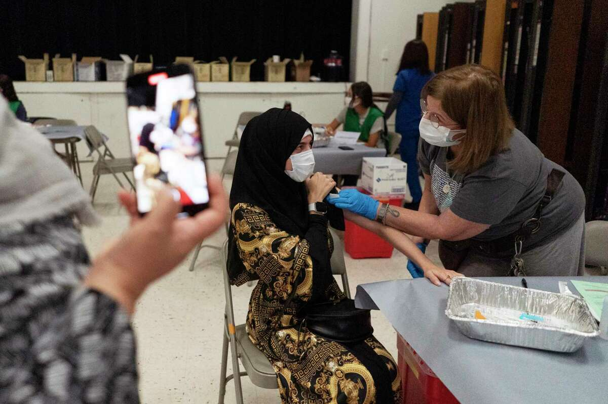 Fathemi Fnu gets her COVID-19 vaccination at Vacaville High School.