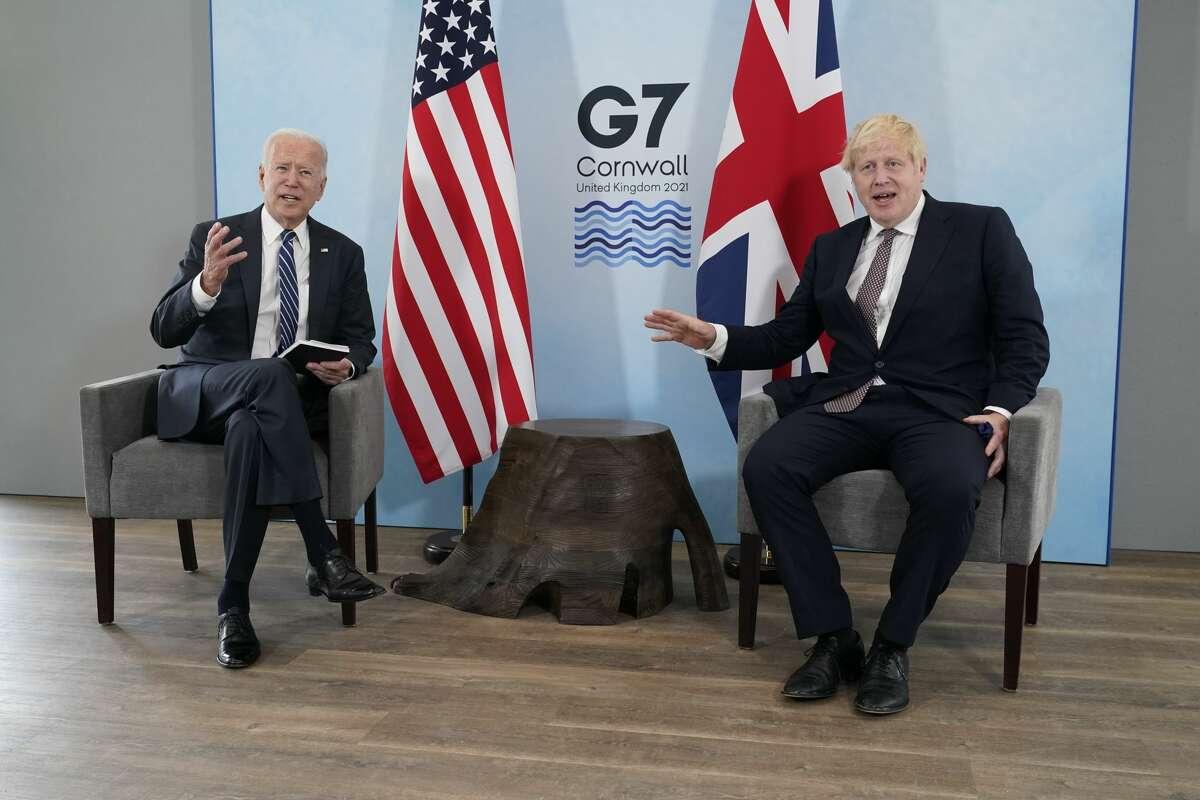 President Joe Biden and British Prime Minister Boris Johnson visit during a bilateral meeting ahead of the G-7 summit, Thursday, June 10, 2021, in Carbis Bay, England. (AP Photo/Patrick Semansky)