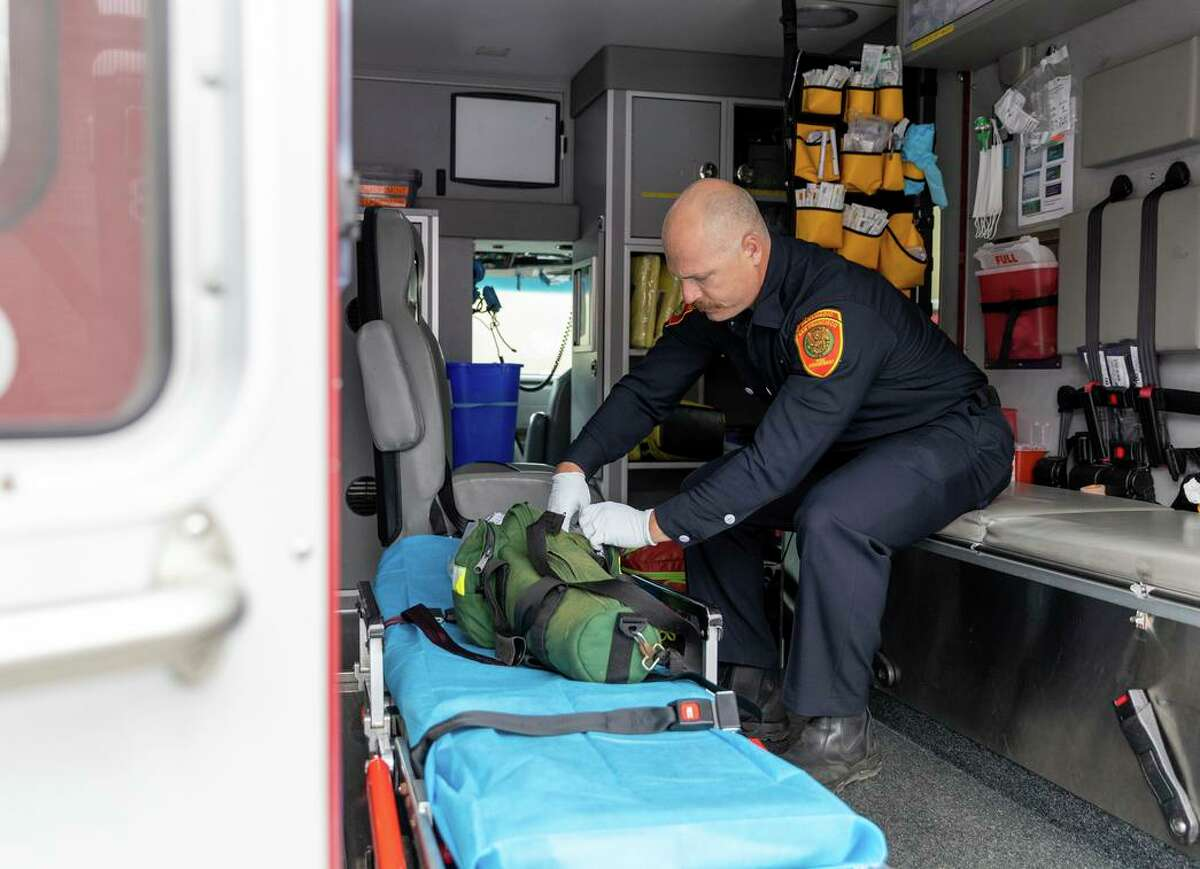 Paramedic Jaziel Mendoza checks equipment before going out on shift from the newly renovated ambulance hub in the Bayview district.