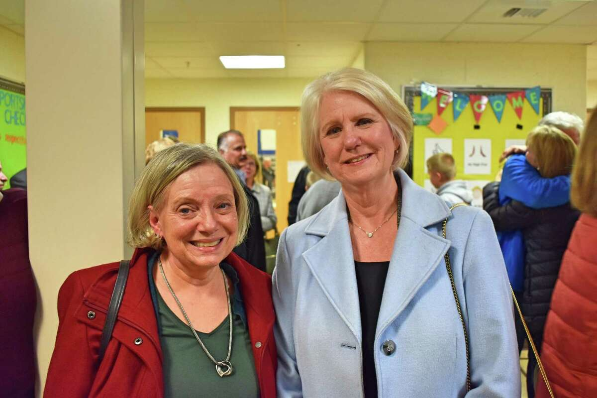 New Fairfield First Selectman Pat Del Monaco, right, and Selectman Khris Hall, left, at Meeting House Hill School following the announcement of the 2019 election results.