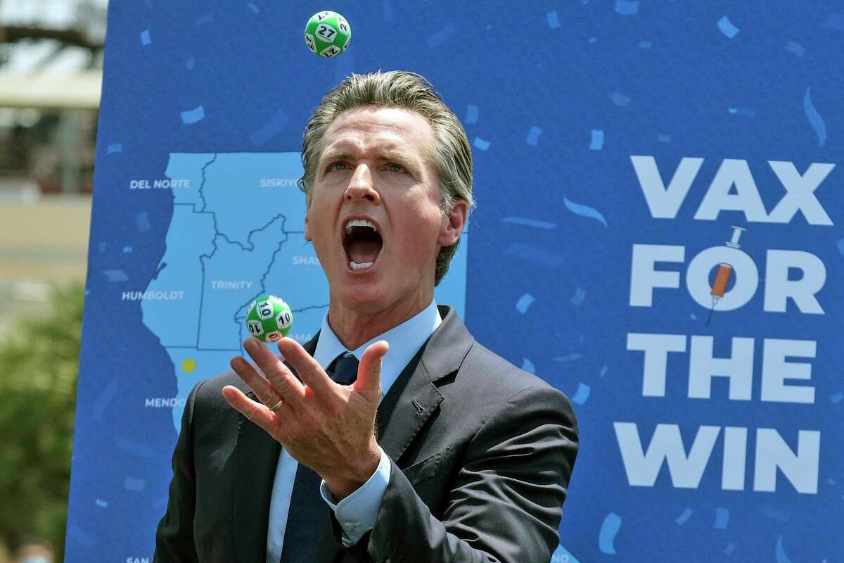 California Gov. Gavin Newsom juggles balls with winning numbers after the Vax for the Win lottery contest during a news conference at Universal Studios in Universal City, Calif., Tuesday, June 15, 2021.
