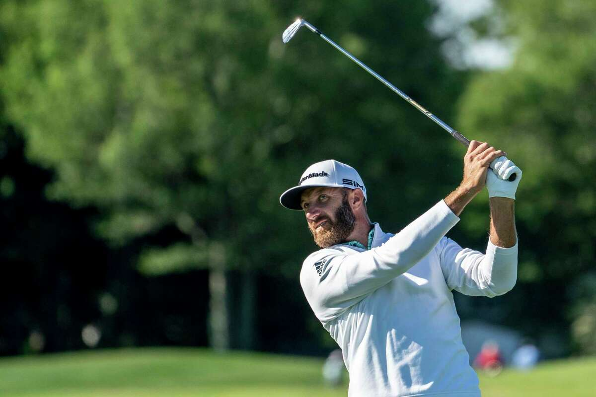 Defending champion Dustin Johnson hits from the seventh hole fairway during the Pro-AM ahead of the Travelers Championship at TPC River Highlands on Wednesday in Cromwell.