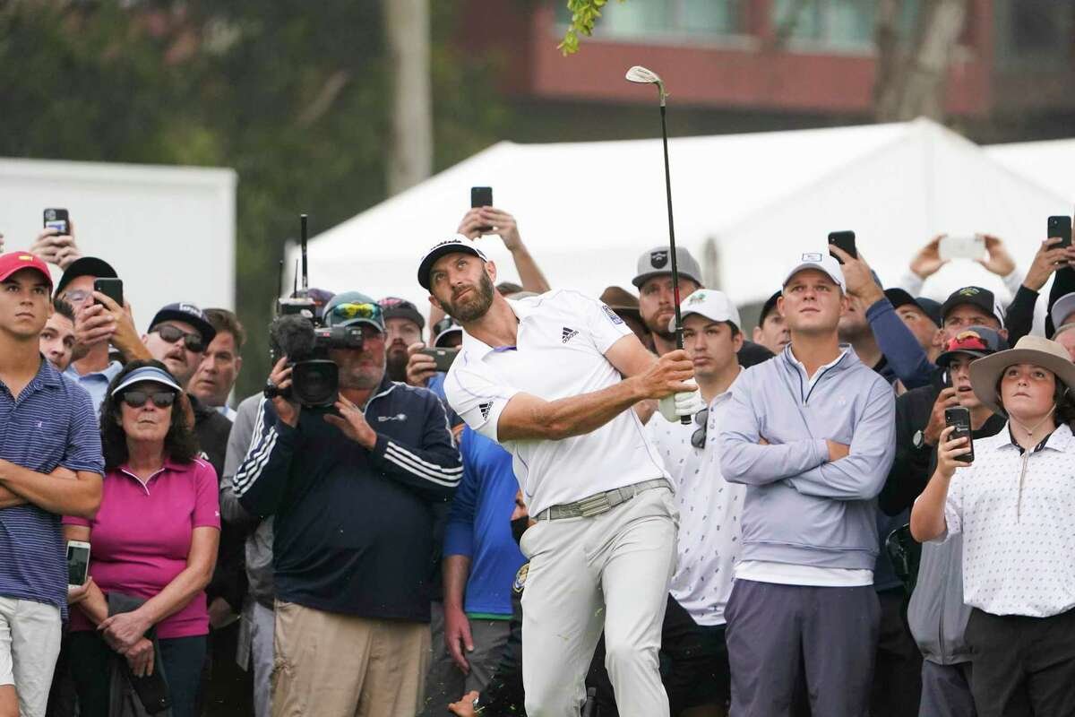 Dustin Johnson watches his shot during the second round of the U.S. Open on Friday at Torrey Pines Golf Course in San Diego.