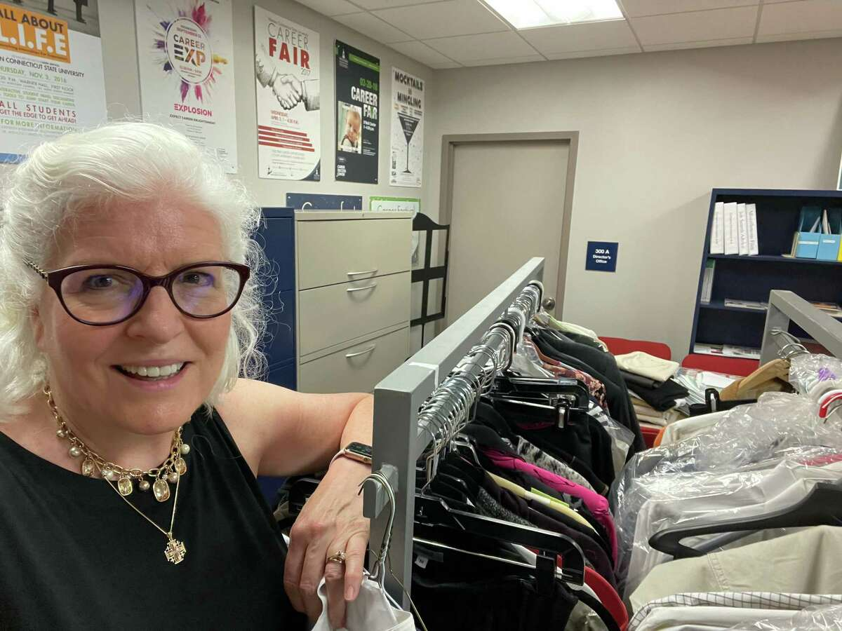 Kathleen Lindenmayer and some of the clothes she has collected from the community