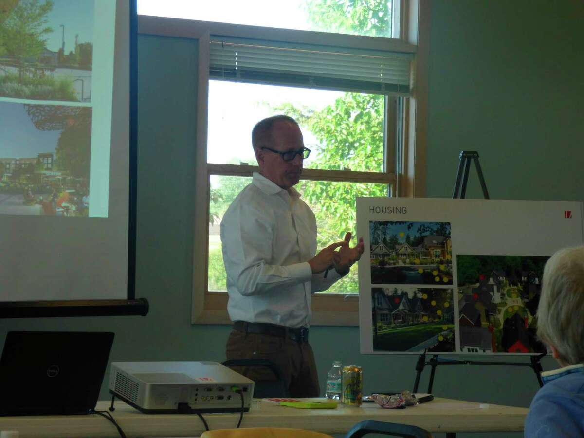 Mike Corby, design principal with Integrated Architecture discusses feedback received at Tuesday's meeting for a potential development in Filer Township. (Scott Fraley/News Advocate)