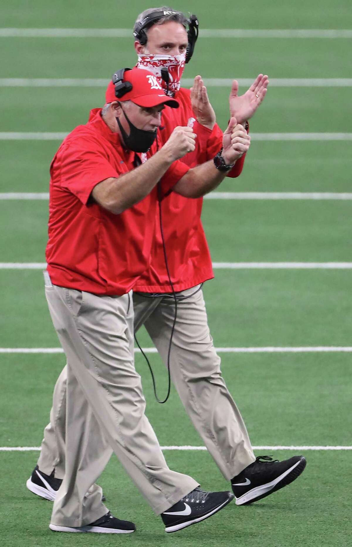Katy head coach Gary Joseph celebrates running back Isaiah Smith's 55-yard touchdown run against Cedar Hill during the first half of the Class 6A Division II UIL State Championship high school football game at AT&T Stadium Saturday, Jan. 16, 2021, in Arlington, Texas. Katy captured the championship with a 51-14 win over Cedar Hill.
