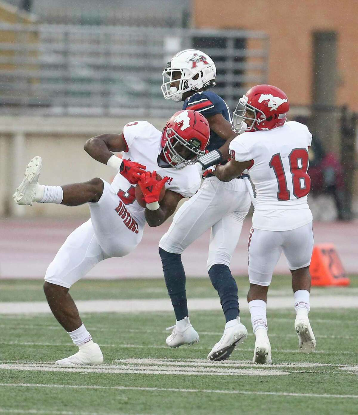 North Shore Mustangs cornerback Denver Harris (3) intercepts the ball against Atascocita Eagles wide receiver Landen King (13) in the first quarter in a high school football game on November 27, 2020 at Turner Stadium in Humble, TX.