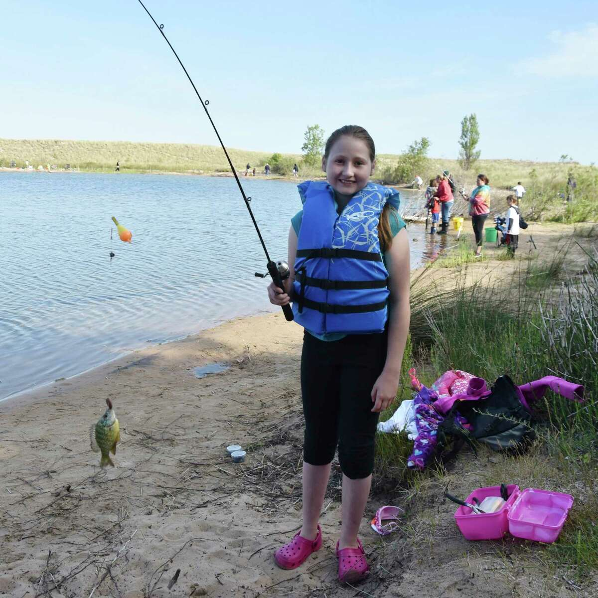 Emma Campbell, 10, caught a bluegill on her first cast at the Kids Fish Day event at Man Made Lake on Wednesday morning. (Arielle Bren/News Advocate)