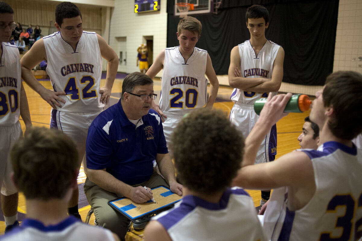 Calvary Baptist boys' basketball coach John VanHolstyn addresses his players during a timeout in a March 17, 2016 game against Lakecrest Baptist.