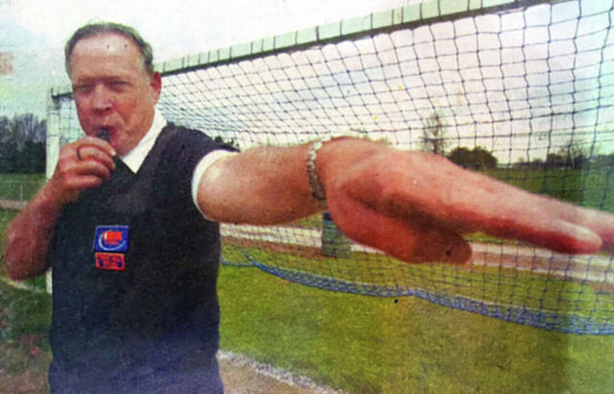 The late Ted Klasner in a 2012 Telegraph photo when he was named the Illinois Official of the Year in Girls Soccer Award from the National Federation of Officials Association. Klasner died May 25.