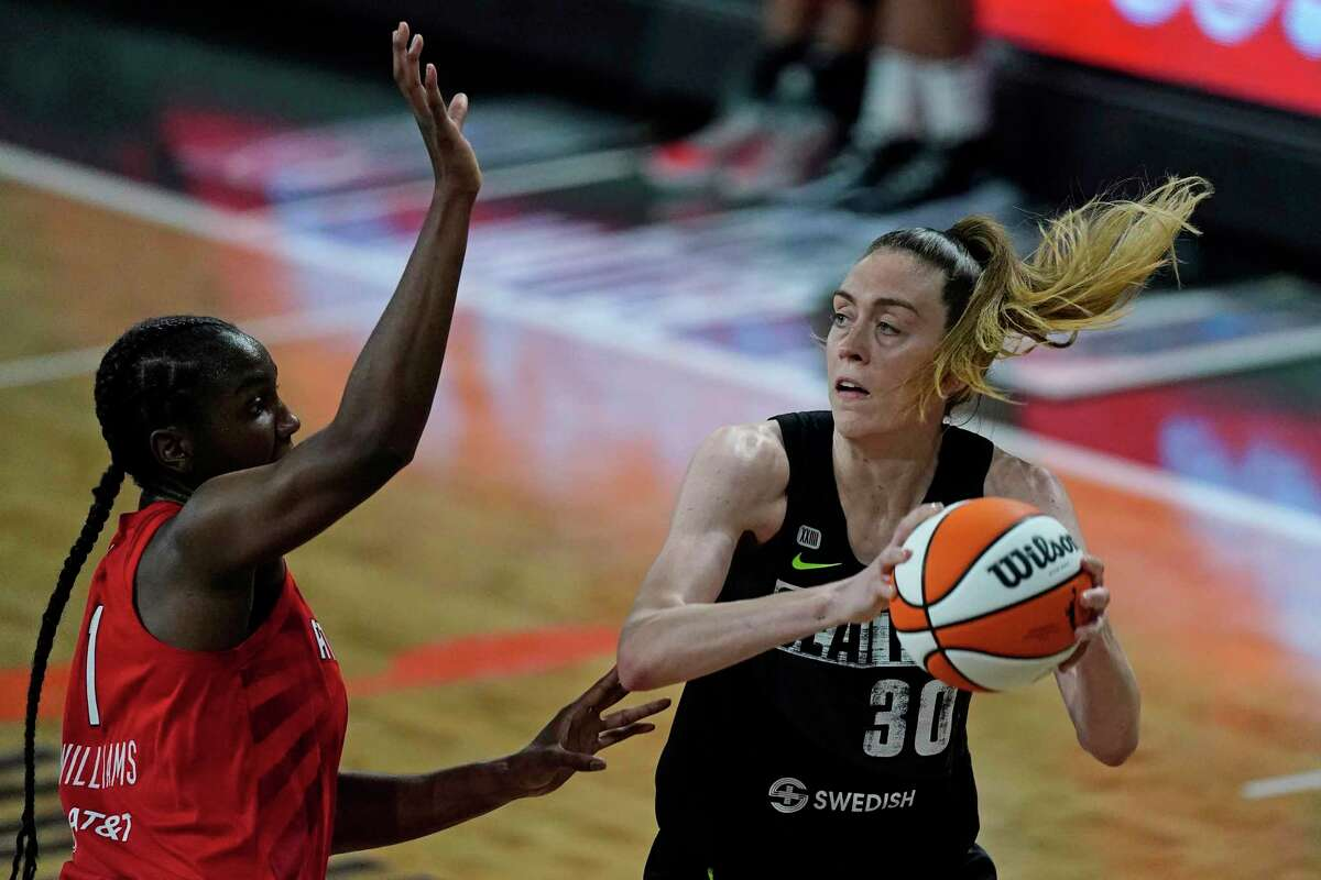 Seattle Storm forward Breanna Stewart, right, tries to pass as Atlanta Dream center/forward Elizabeth Williams, left, defends during the first half during a game on June 9.
