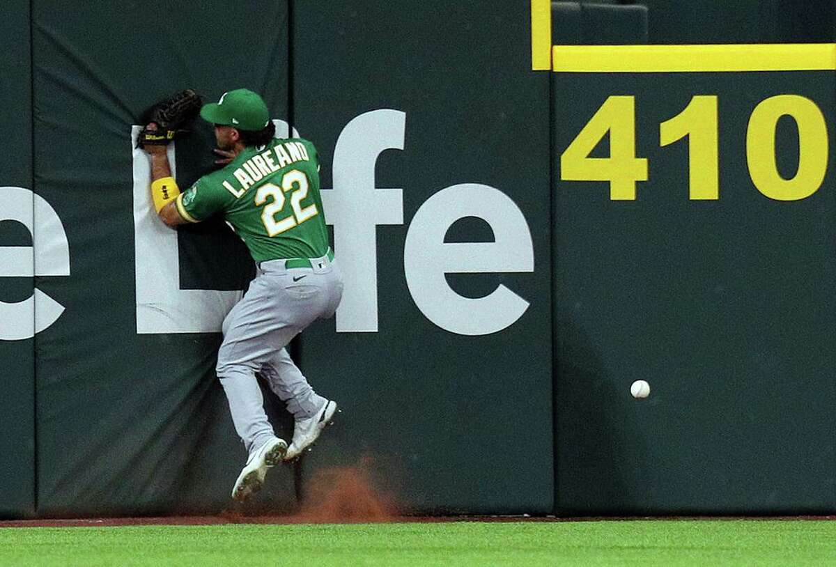 ARLINGTON, TEXAS - JUNE 21: Ramon Laureano #22 of the Oakland Athletics hits the wall chasing a ball hit by Adolis Garcia of the Texas Rangers for a double in the first inning at Globe Life Field on June 21, 2021 in Arlington, Texas. (Photo by Richard Rodriguez/Getty Images)