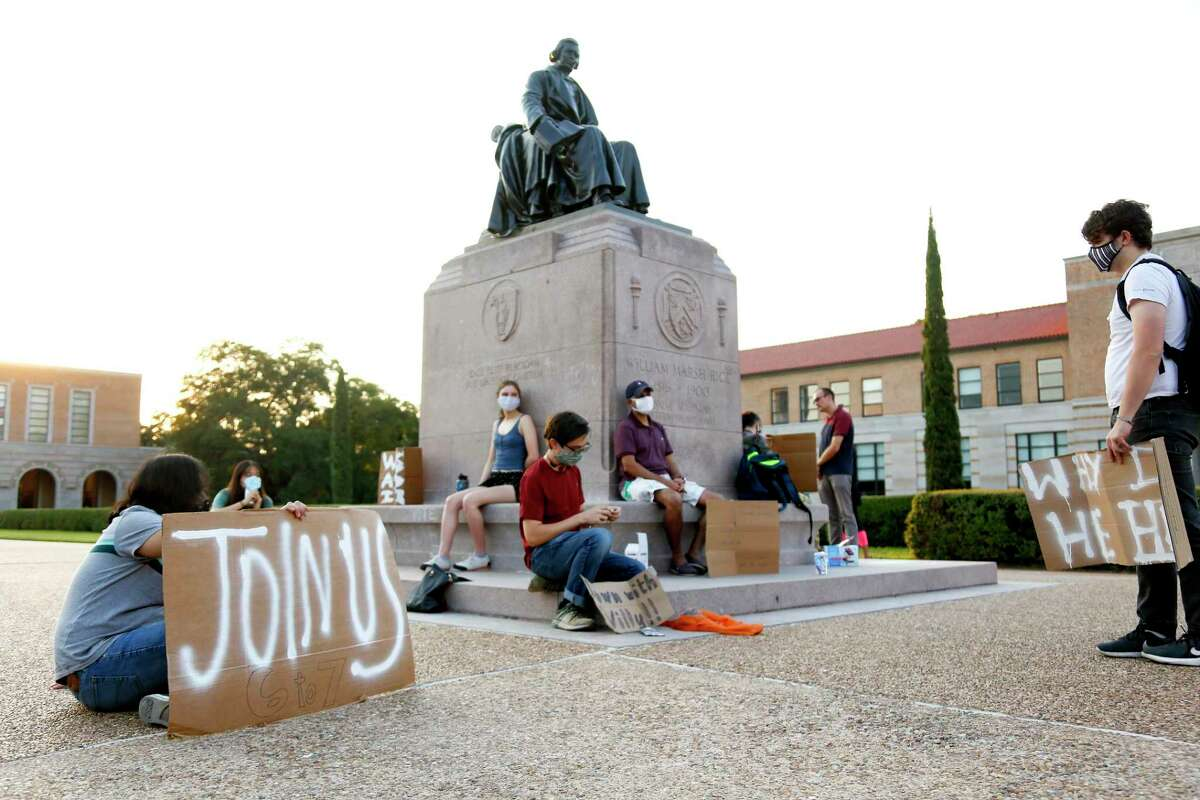 Sit-in protesters gather around the statue of William Marsh Rice on the campus of the Houston university on Monday, Oct. 5, 2020. Junior Shifa Rahman has hosted a daily sit-in since Aug. 31.