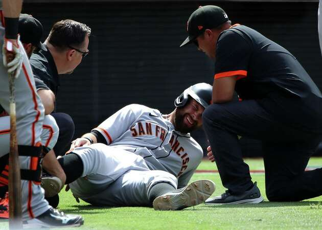 Story photo for Good medical news on Giants' Brandon Belt, who could avoid knee surgery