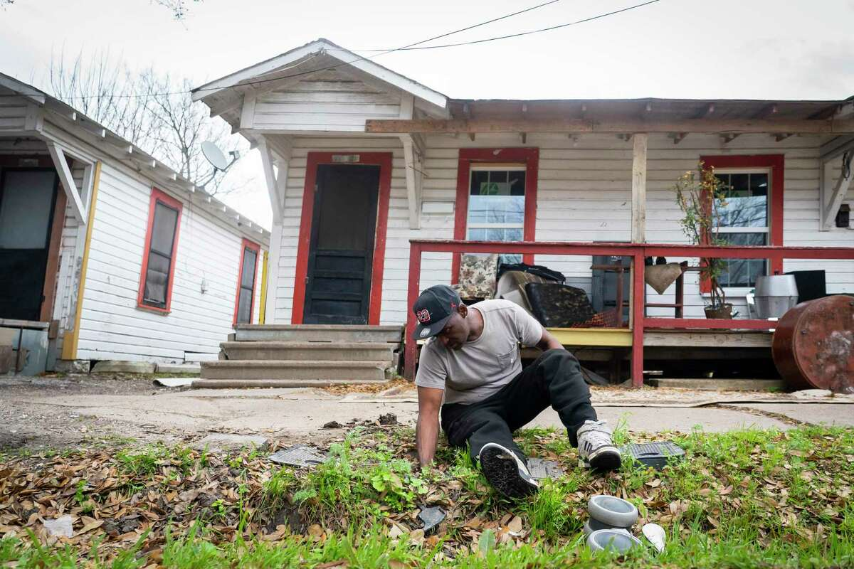 Norris Williams shuts off the water to his home in Fifth Ward on Wednesday, March 10, 2021, in Houston. Burst pipes along a row of four rental houses on the street had left Williams' family without running water since the freeze in February.
