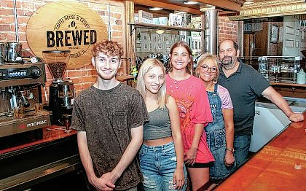 Hunter Gates (from left), Hailey Brewer, Ella Pepper and Brewer Coffee House & Eatery owners Tammy and Bob Brewer stand behind the counter of the shop at 109 N. Madison St. in Pittsfield.