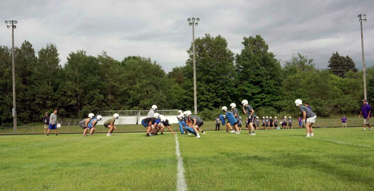 Members of the Morley Stanwood (left of line) and Greenville football teams engage in a joint practice on Wednesday evening at Morley Stanwood's football field. (Pioneer photo/Joe Judd)