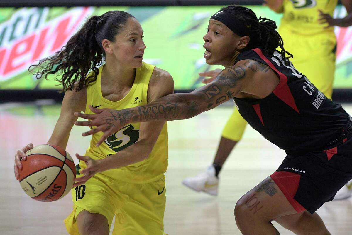 Seattle Storm guard Sue Bird (10) is defended by Las Vegas Aces forward Emma Cannon (32) during the second half of Game 2 of basketball's WNBA Finals in October.