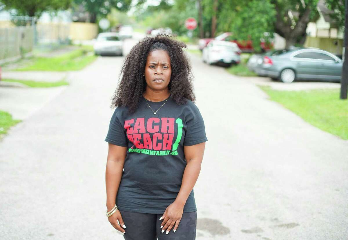 Kendra London stands on the street she grew up in Houston's Fifth Ward neighborhood on Tuesday, June 22, 2021. London, an affordable housing advocate, wants housing to be affordable for people who grew up in the neighborhoods and want to stay.
