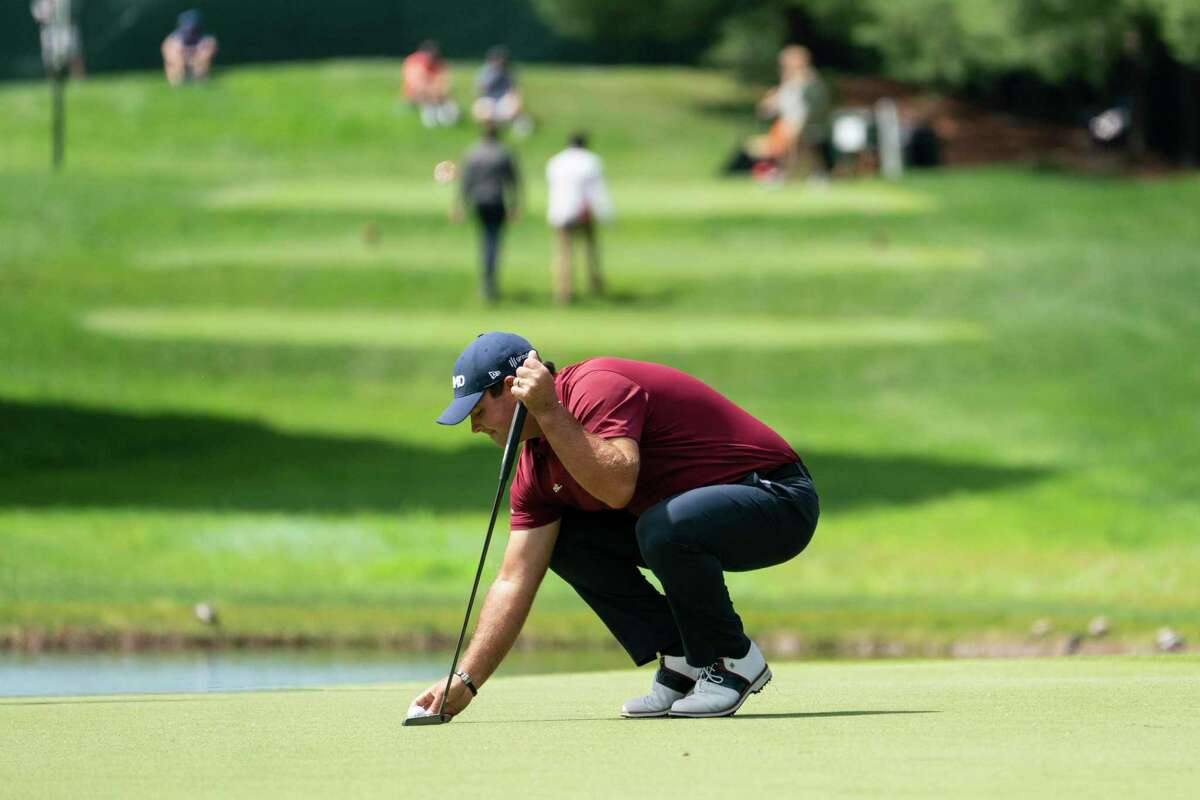 .Patrick Reed sets up his shot on the eighth green during pro-am team play ahead of the Travelers Championship golf tournament at TPC River Highlands, Wednesday, June 23, 2021, in Cromwell, Conn.