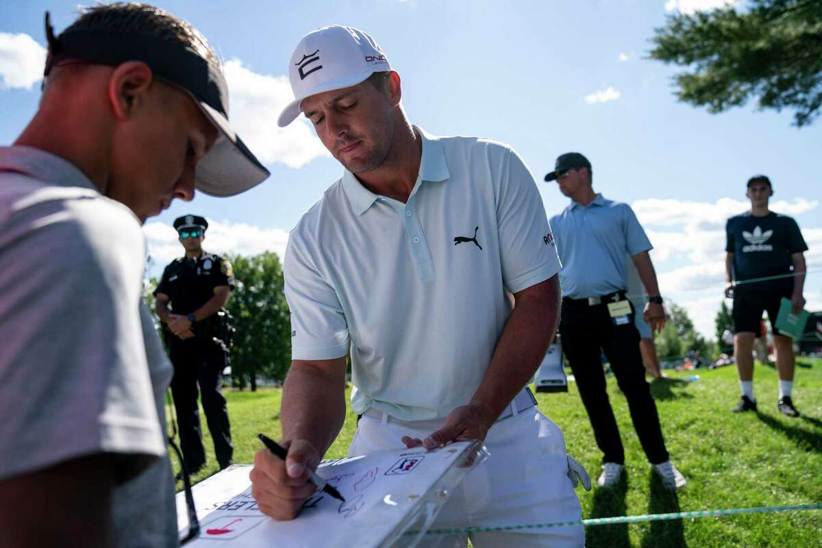 Bryson DeChambeau signs autographs for fans during the Pro-AM ahead of the Travelers Championship at TPC River Highlands on Wednesday in Cromwell.