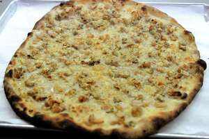 Pepe's specialty, white clam pizza.