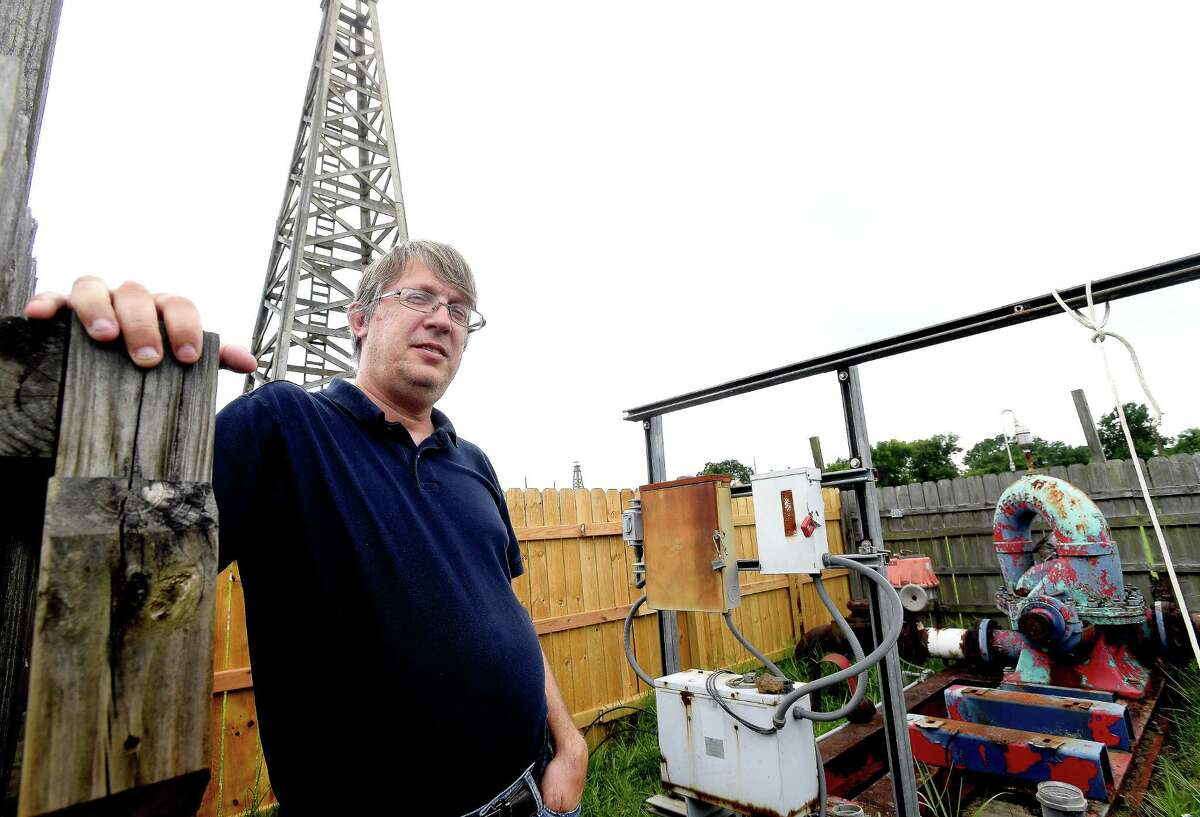 Spindletop Gladys City Boomtown Museum Director Troy Gray stands inside the pump unit that was badly damaged during the winter freeze, leaving the museum without one of its favorite features for visitors - the blowing of the gusher. Gray recently got word that help was on the way, and the unit is out for repairs, with hopes of a return by July. Photo made Tuesday, June 22, 2021 Kim Brent/The Enterprise