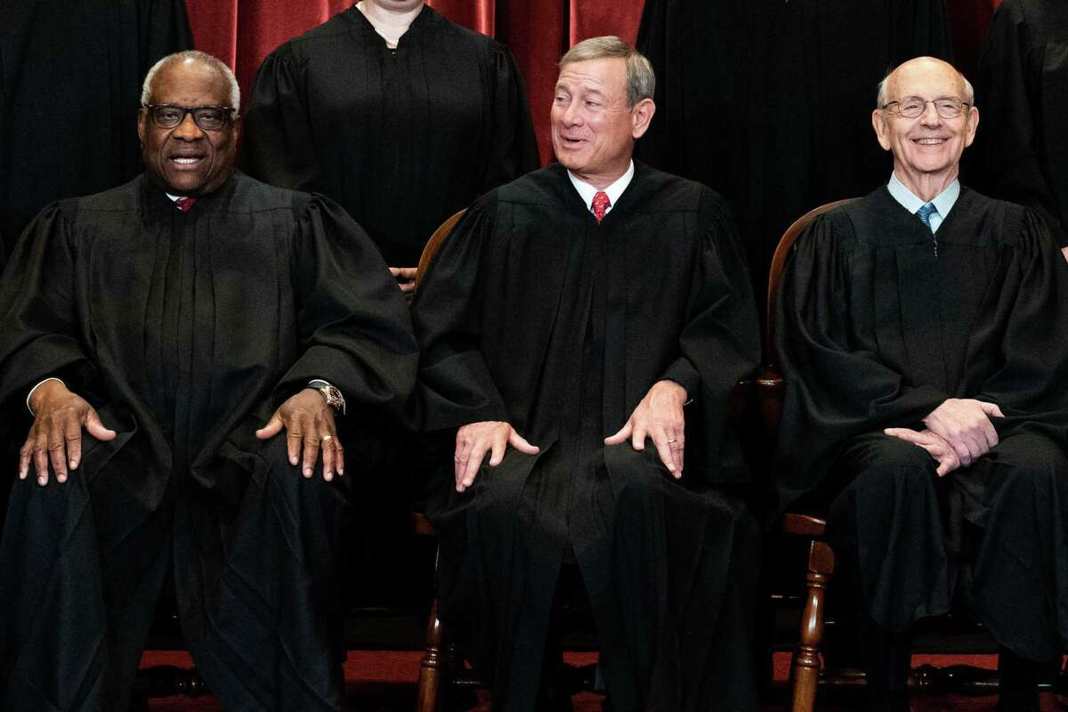 (FILES) In this file photo members of the Supreme Court pose for a group photo at the Supreme Court in Washington, DC on April 23, 2021, seated (L-R) Associate Justice Clarence Thomas, Chief Justice John Roberts and Associate Justice Stephen Breyer. - Pressure on US Chief Justice Stephen Breyer to retire is growing: progressive Democrats are anxiously eyeing his seat, Republicans have laid down the gauntlet, and issues from abortion to voting rights could all be at stake. Top Senate Republican Mitch McConnell turned up the heat on June 14, 2021 when he said his party would block anyone nominated to Supreme Court by Democratic President Joe Biden if Republicans regain control of the Senate in the 2022 midterm elections. (Photo by Erin SCHAFF / POOL / AFP) (Photo by ERIN SCHAFF/POOL/AFP via Getty Images)