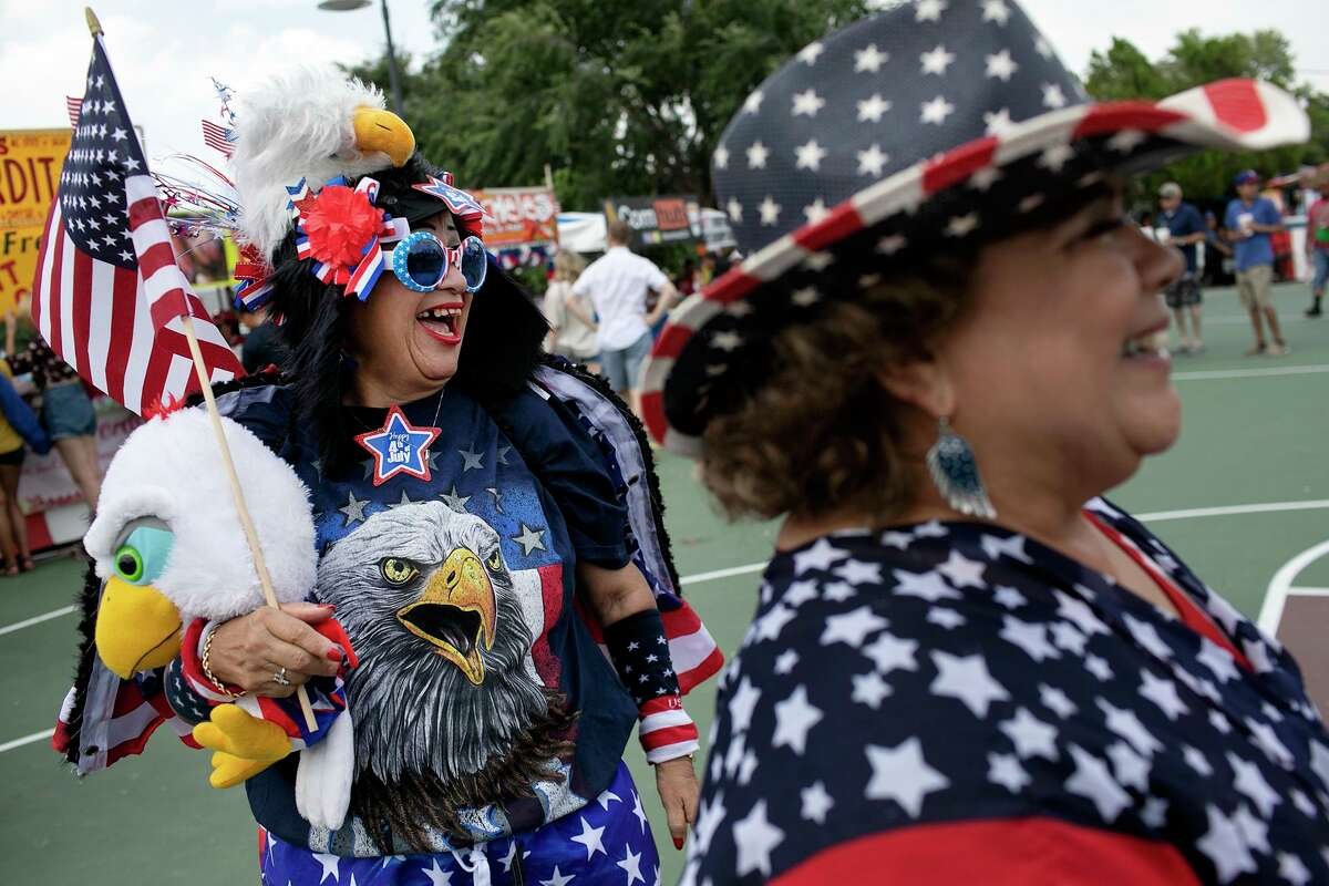 Sovia Lauriano, left, and Josie Falcon celebrate during the 2019 Fourth of July celebration at Woodlawn Lake Park. The holiday event was canceled in 2020 because of the pandemic but is making its return this year.