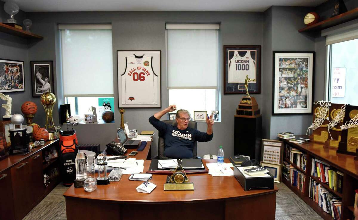 UConn women's basketball coach Geno Auriemma chats in his office at the Werth Family UConn Basketball Champions Center on the UConn main campus in Storrs, Conn. Monday, June 14, 2021.
