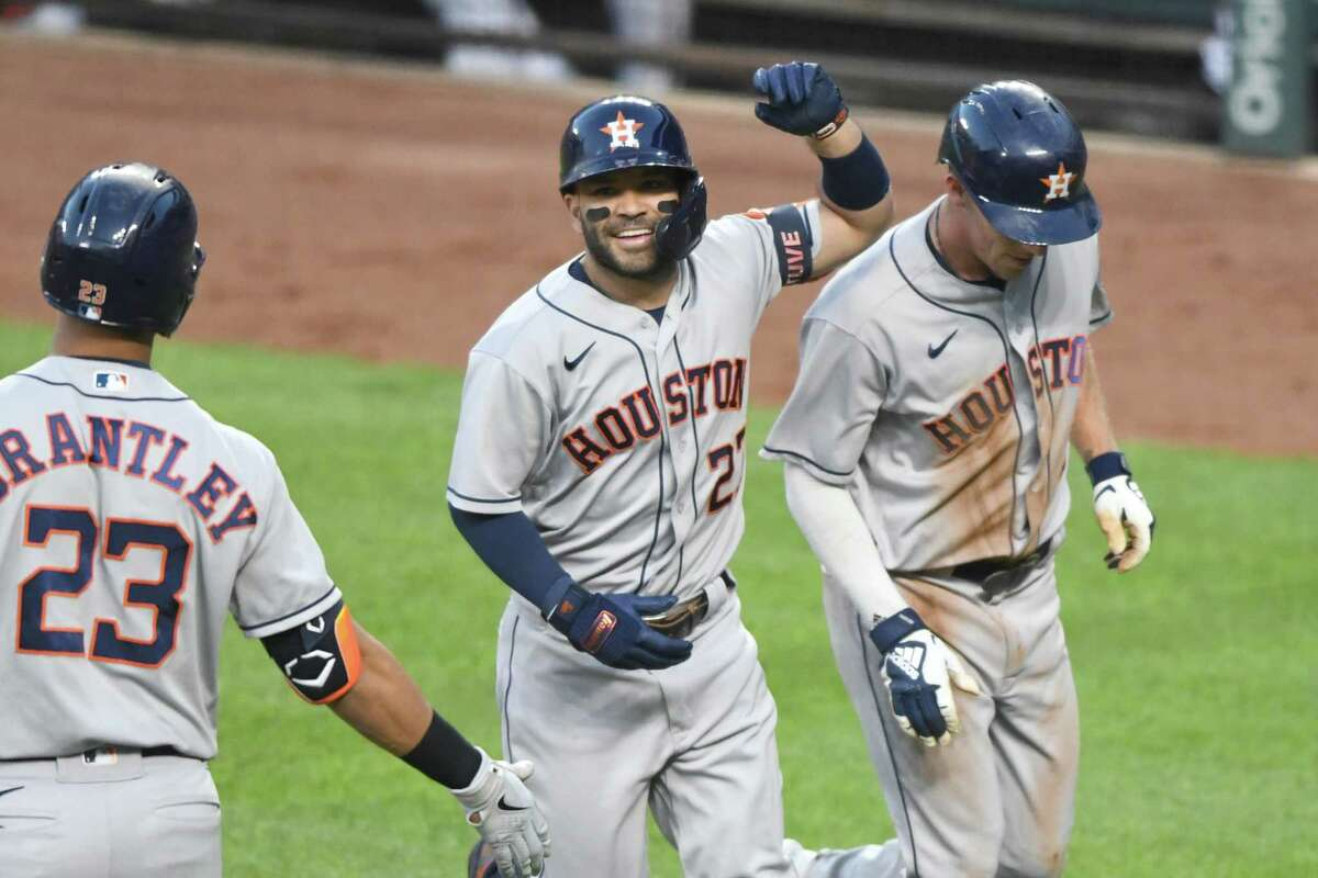 Jose Altuve (center) celebrates a home run Wednesday during the Astros' 13-0 win at Baltimore that pushed their winning streak to 10 games.