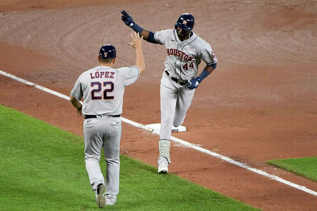 Houston Astros' Yordan Alvarez (44) celebrates with third base coach Omar Lopez (22) after hitting a solo home run against the Baltimore Orioles in the seventh inning of a baseball game, Wednesday, June 23, 2021, in Baltimore. (AP Photo/Will Newton)