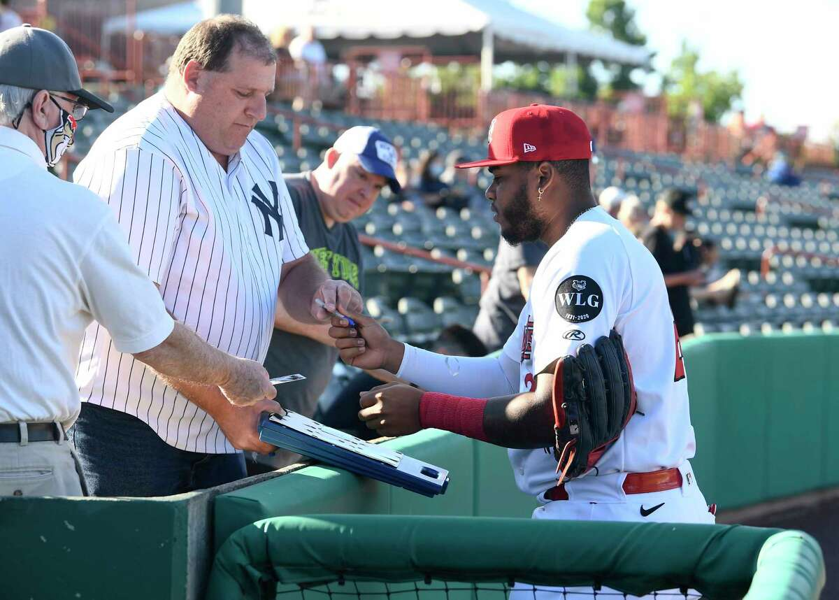Tri-City ValleyCats Willy Garcia (24) signs autographs for fans before the start of a minor league baseball game against the Sussex County Miners in Troy, N.Y., Wednesday, June 23, 2021. (Hans Pennink / Special to the Times Union) ORG XMIT: 062321_hsfb1_HP105