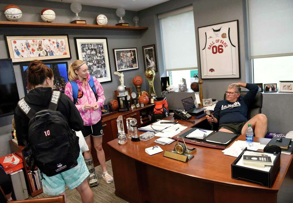UConn women's basketball coach Geno Auriemma chats with sophomore guards Nika Mühl, left, and Paige Bueckers in his office at the Werth Family UConn Basketball Champions Center on the UConn main campus in Storrs, Conn. Monday, June 14, 2021.