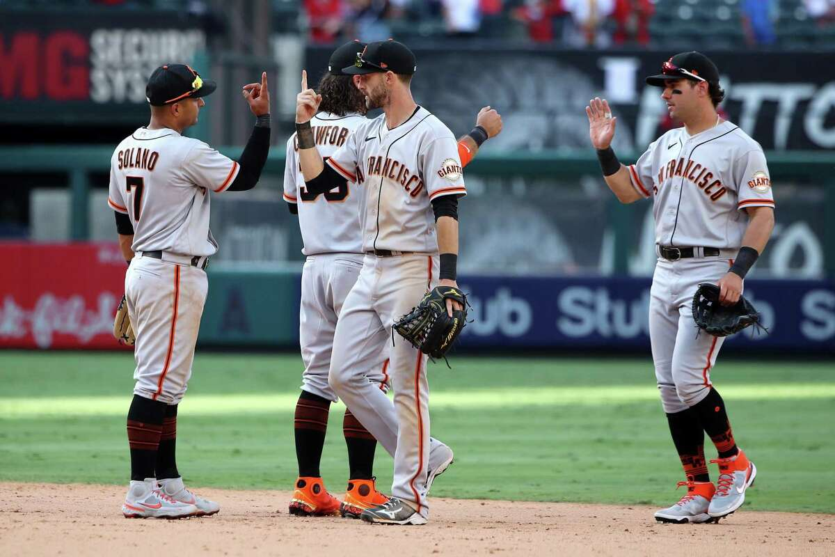 ANAHEIM, CALIFORNIA - JUNE 23: Donovan Solano #7, Brandon Crawford #35, Steven Duggar #6 and Mike Tauchman #29 of the San Francisco Giants celebrate a 9-3 win against the Los Angeles Angels at Angel Stadium of Anaheim on June 23, 2021 in Anaheim, California. (Photo by Katelyn Mulcahy/Getty Images)