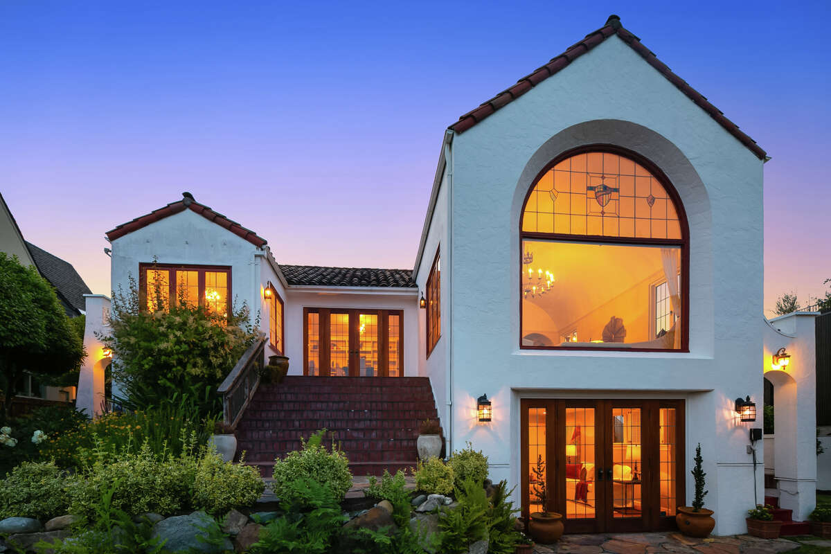 With the sunset and golden interior glow, this stunner has supreme curb appeal.