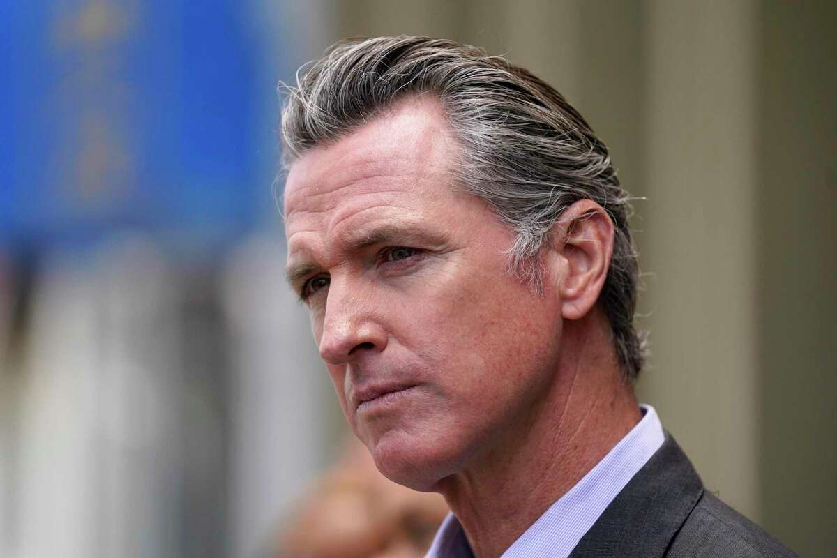 California Gov. Gavin Newsom listens to questions during a news conference outside a restaurant in San Francisco on June 13, 2021.