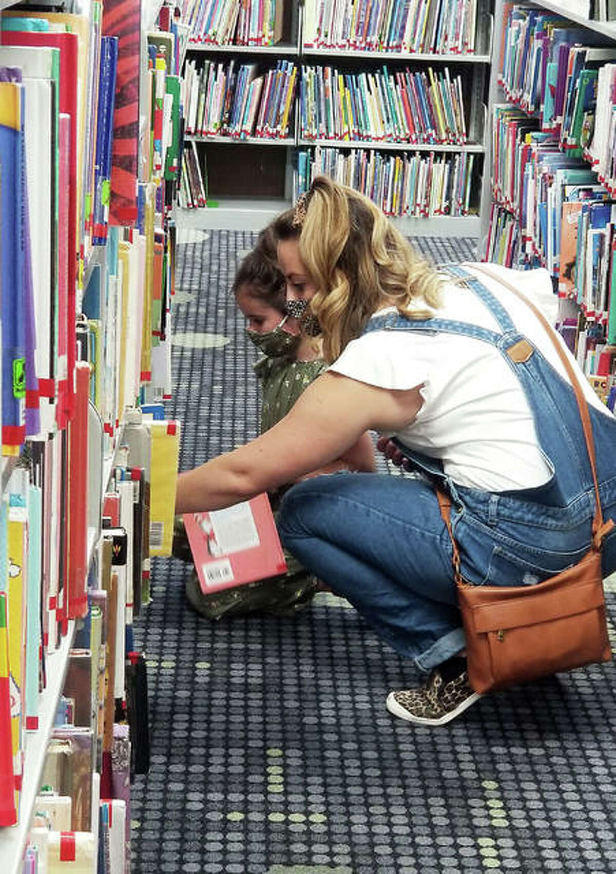 Since resident Christina Armour has her summer reading list set, she helped her daughter Lillian find some books at Edwardsville Public Library this week.