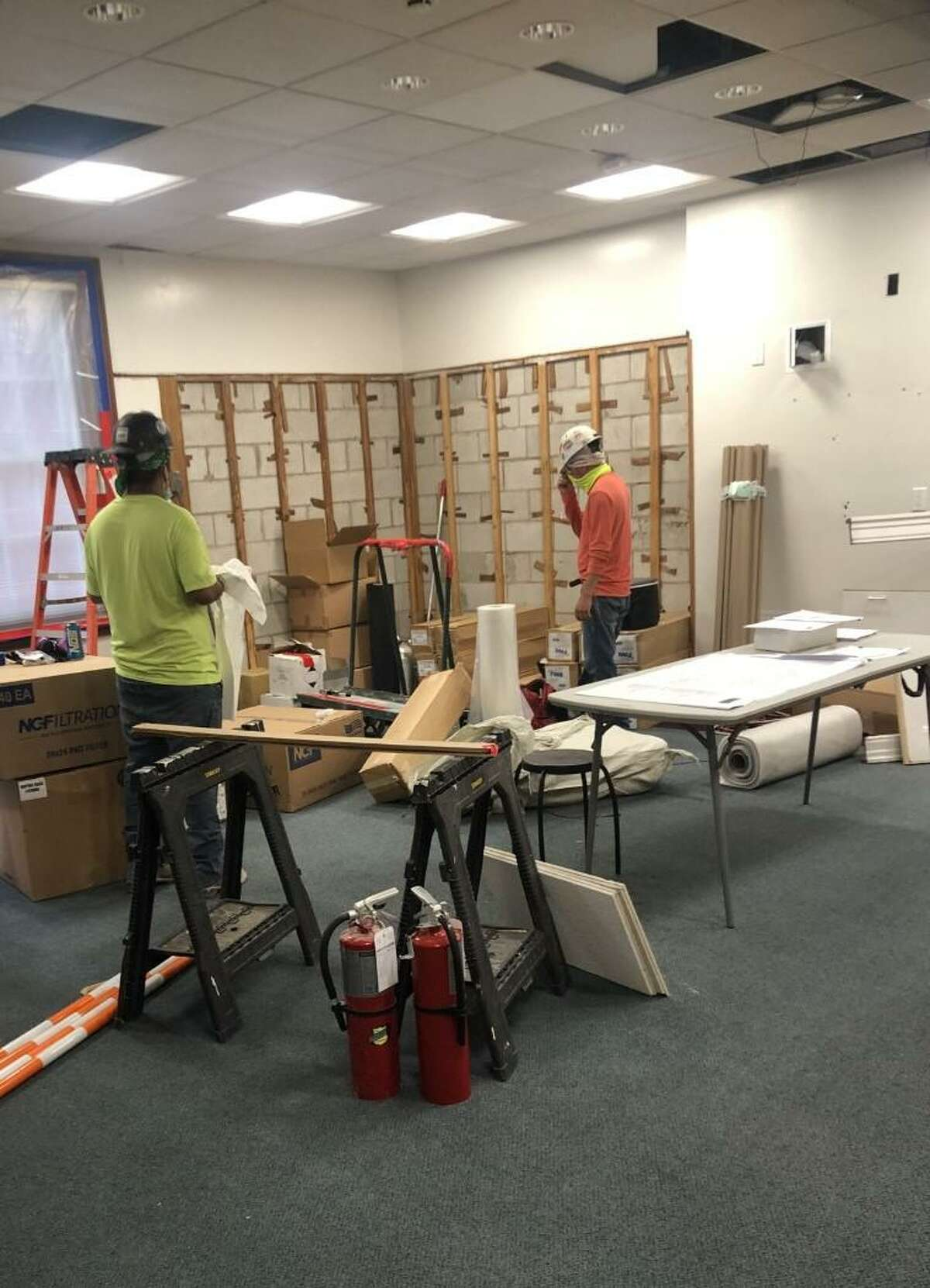 Construction workers at the John B. Pierce Laboratory on Congress Street in New Haven work on developing a biotech incubator at the facility. The New Haven Innovation Labs incubator will open in October.