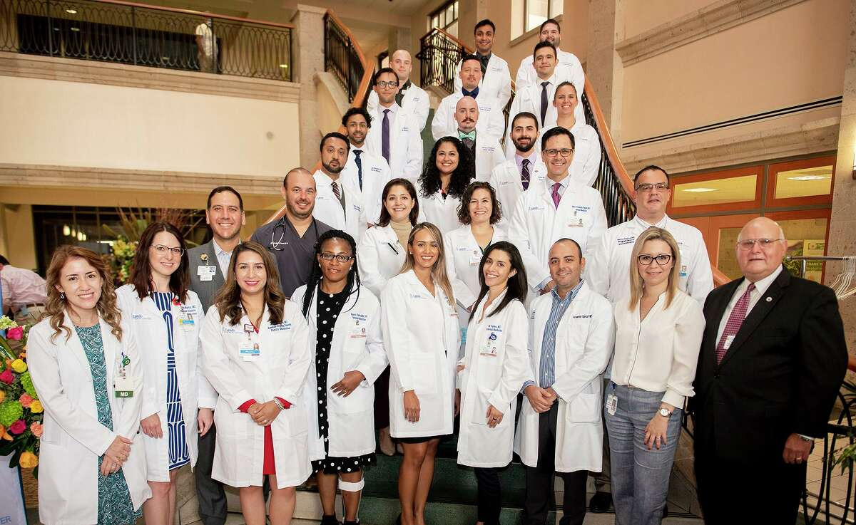 Laredo Medical Center physicians, staff and Gateway Community Health Center leadership stand with the fourth cohort of the Family Medicine and Internal Medicine Residency Program, Wednesday, June 23, 2021, at LMC during a White Coat Ceremony.