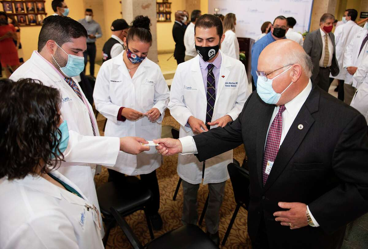 Members of the fourth cohort of the Family Medicine Residency Program meet with Gateway Community Center CEO Elmo Lopez Jr. Wednesday, June 23, 2021, at LMC after a White Coat Ceremony.