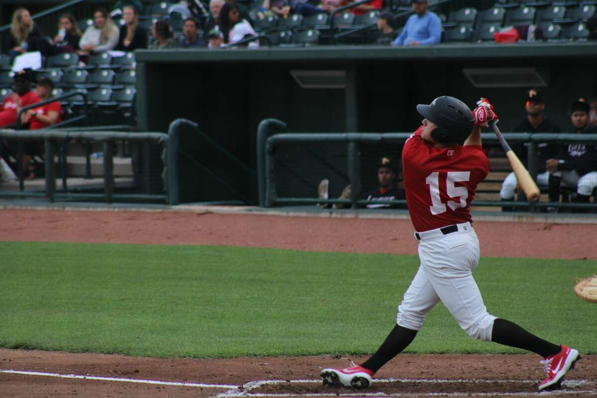 Loons left fielder Ryan Ward swings against Lake County on June 23 at Dow Diamond