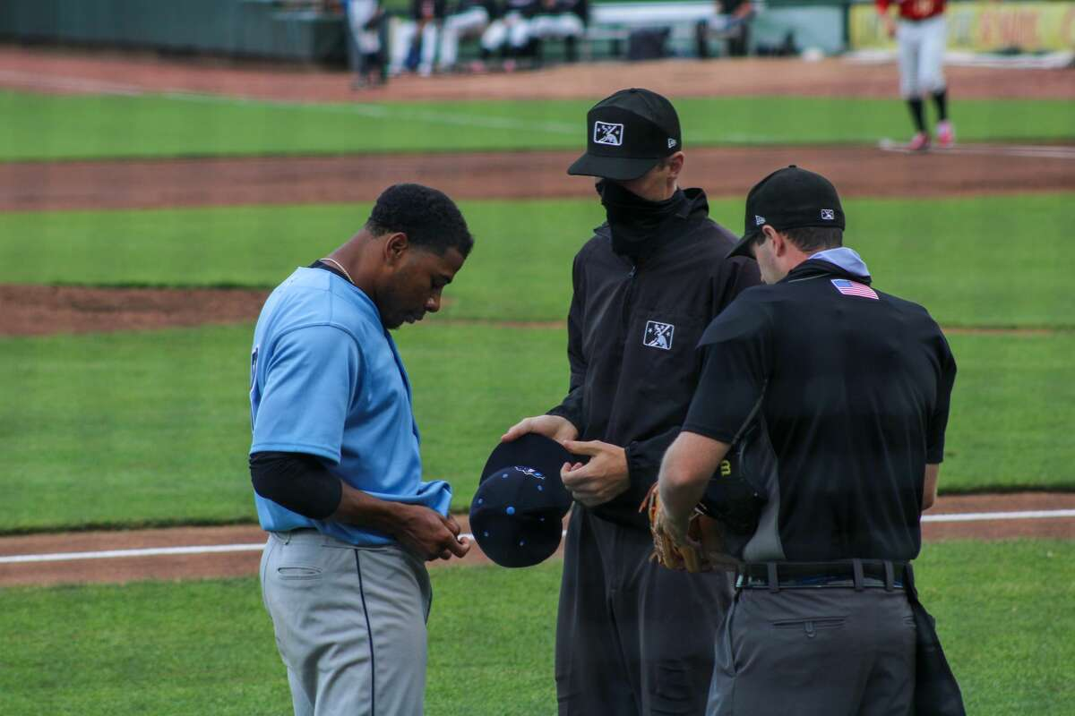 Captains pitcher Xzavion Curry is inspected for a foriegn substance after the first inning against the Loons on June 23 at Dow Diamond