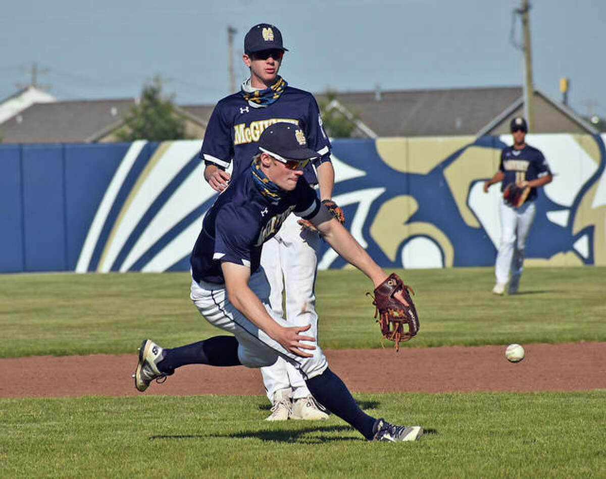 Father McGivney shortstop Matthew Gierer tries to make a barehanded play behind the mound during a game in Glen Carbon.