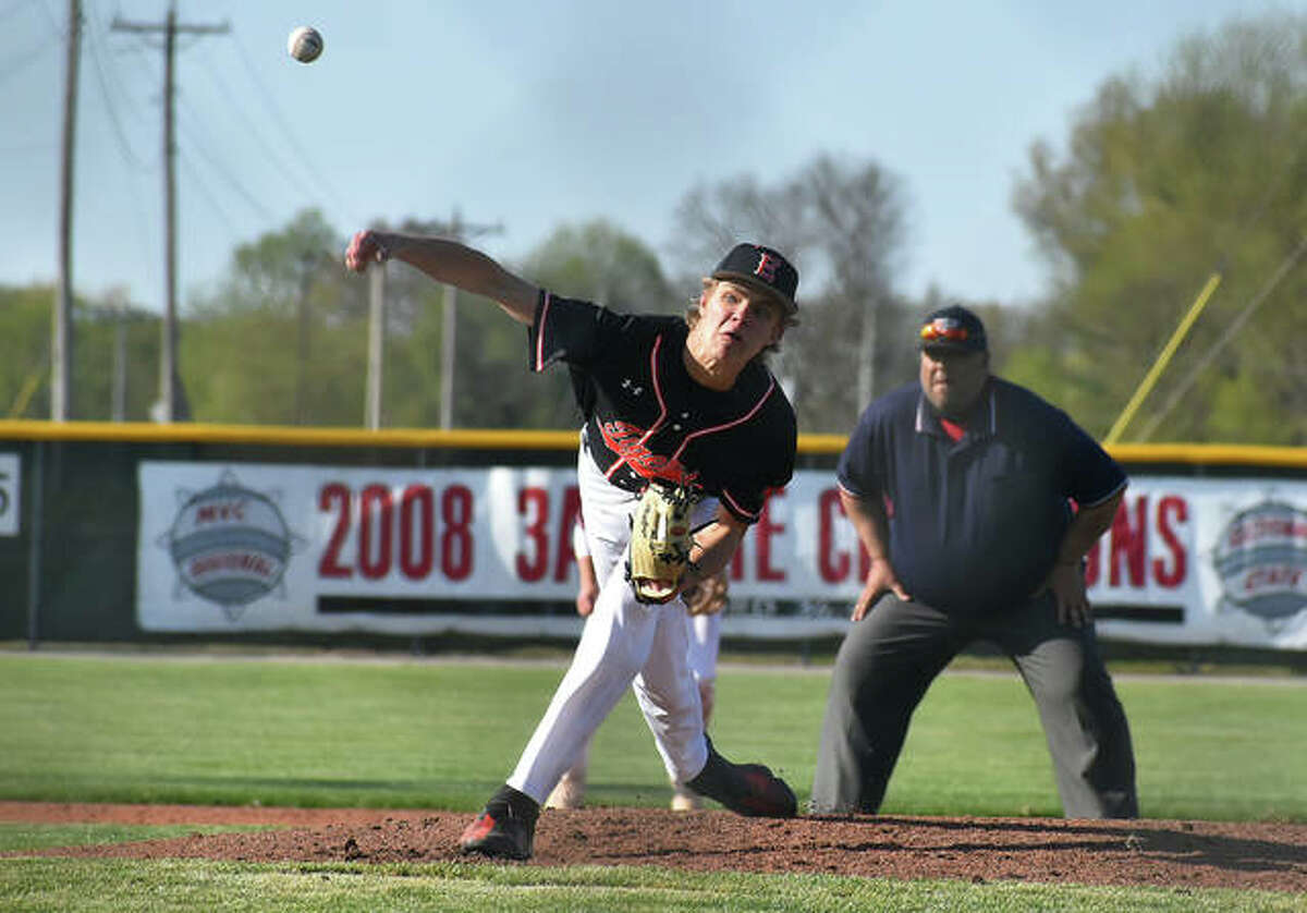 Edwardsville pitcher Quinn Weber delivers a pitch to a Highland hitter during the season opener.