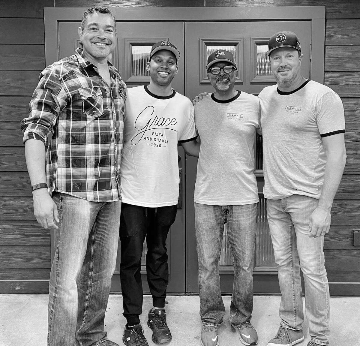 Grace Pizza and Shakes co-owners VJ Nandlal, second from left, and Adrian Hembree, right, recently opened the restaurant in Alvin. Also shown are Hugh Patton, left, and Vince Nandlal Sr.