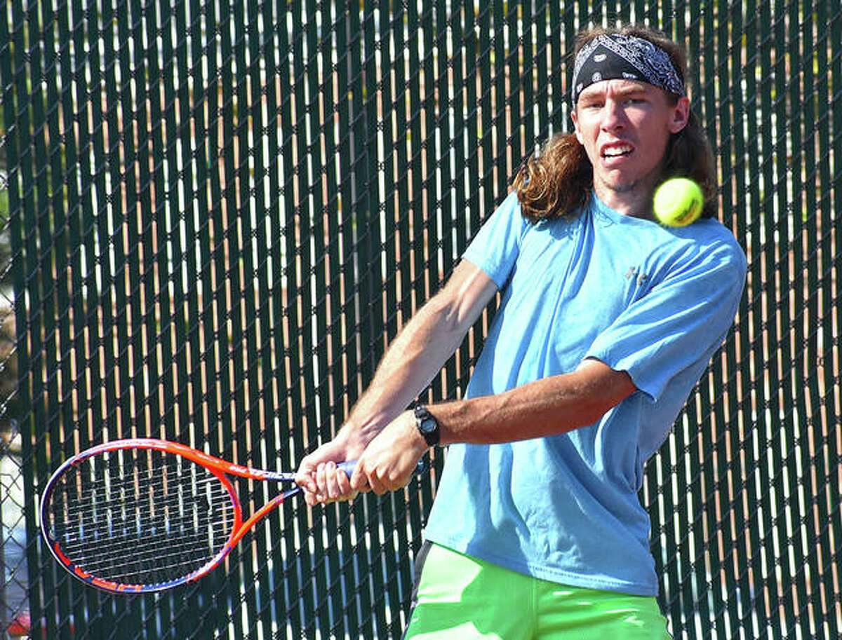 EHS grad Erik Weiler hits a backhand shot during his first-round match in 2019 in the Qualifying Tournament of the Edwardsville Futures.