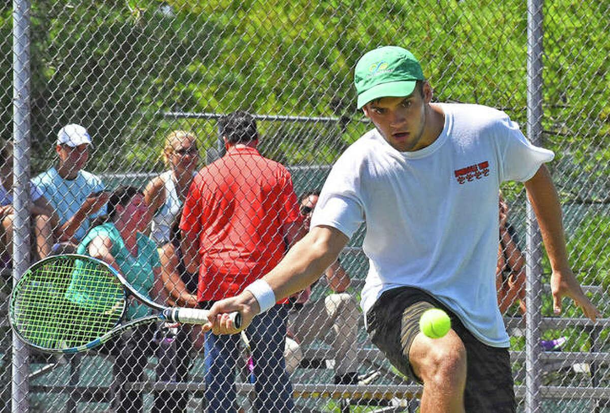 Seth Lipe hits a shot during a match at the EHS Tennis Center.